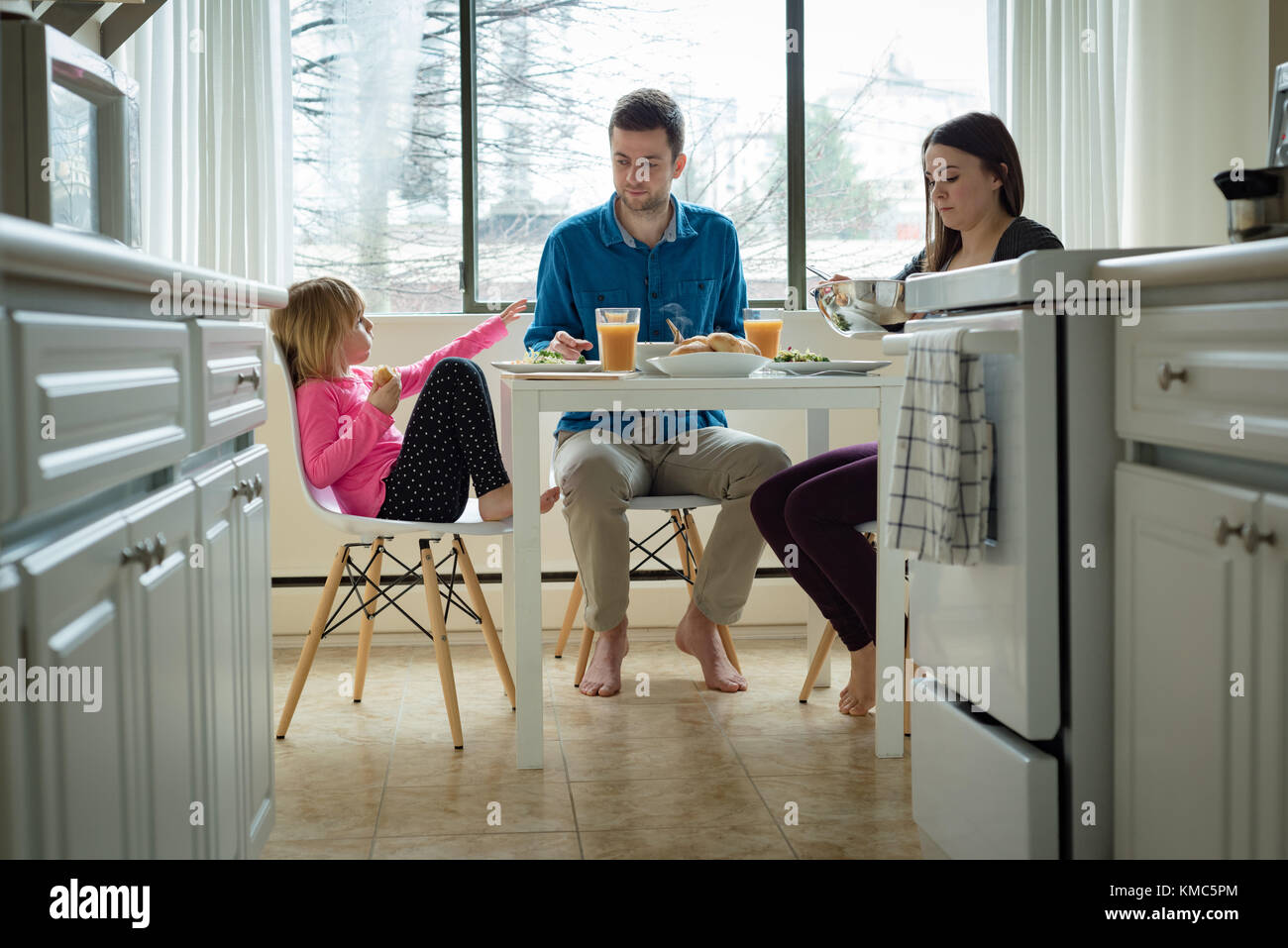 Family having breakfast in kitchen - Stock Image