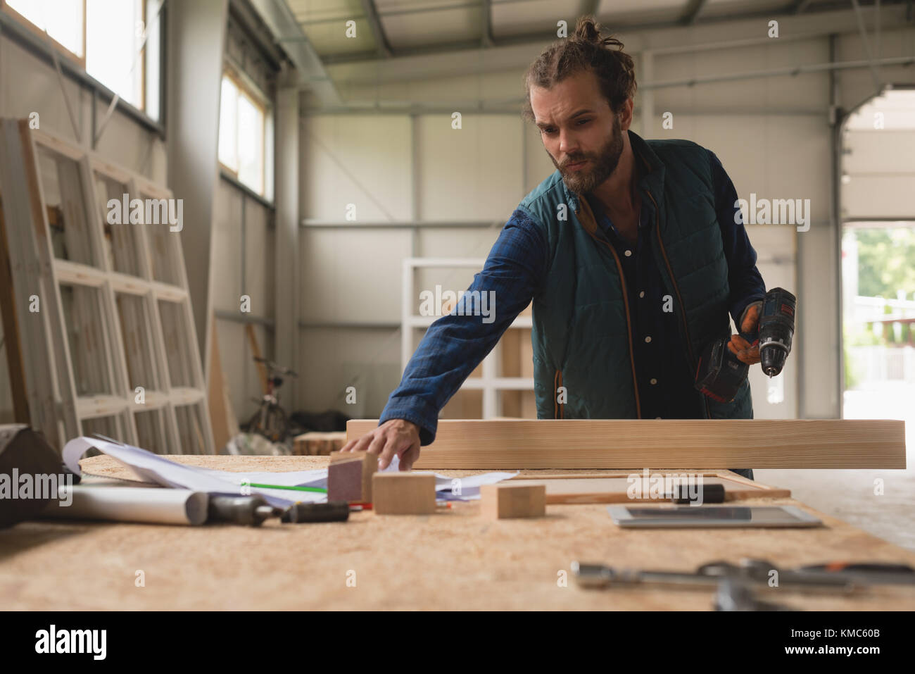 Carpenter working at table - Stock Image