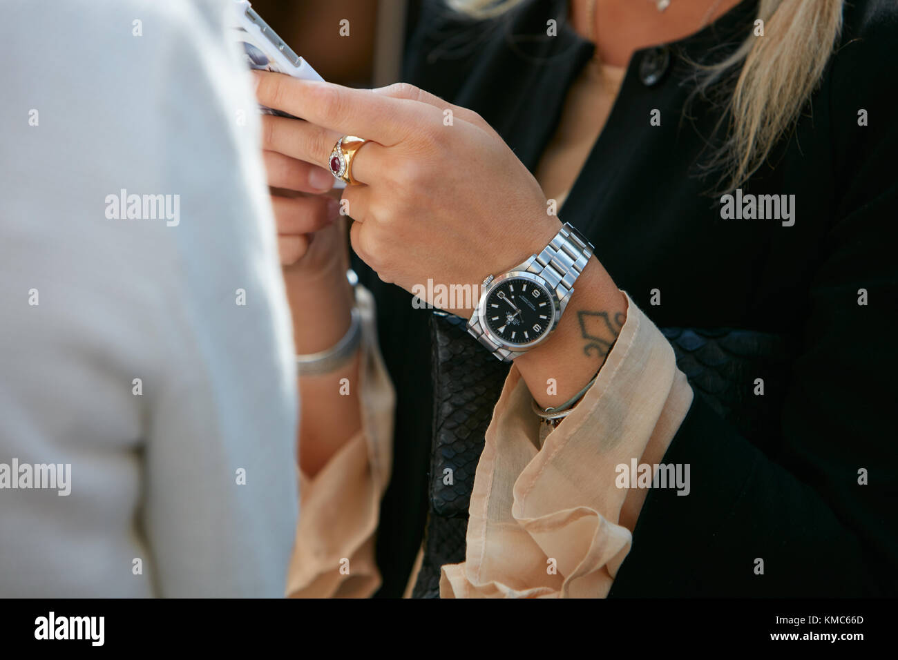 d49a674966ac2f MILAN - SEPTEMBER 23: Woman with Rolex Explorer watch and golden ring  before Antonio Marras fashion show, Milan Fashion Week street style on  September