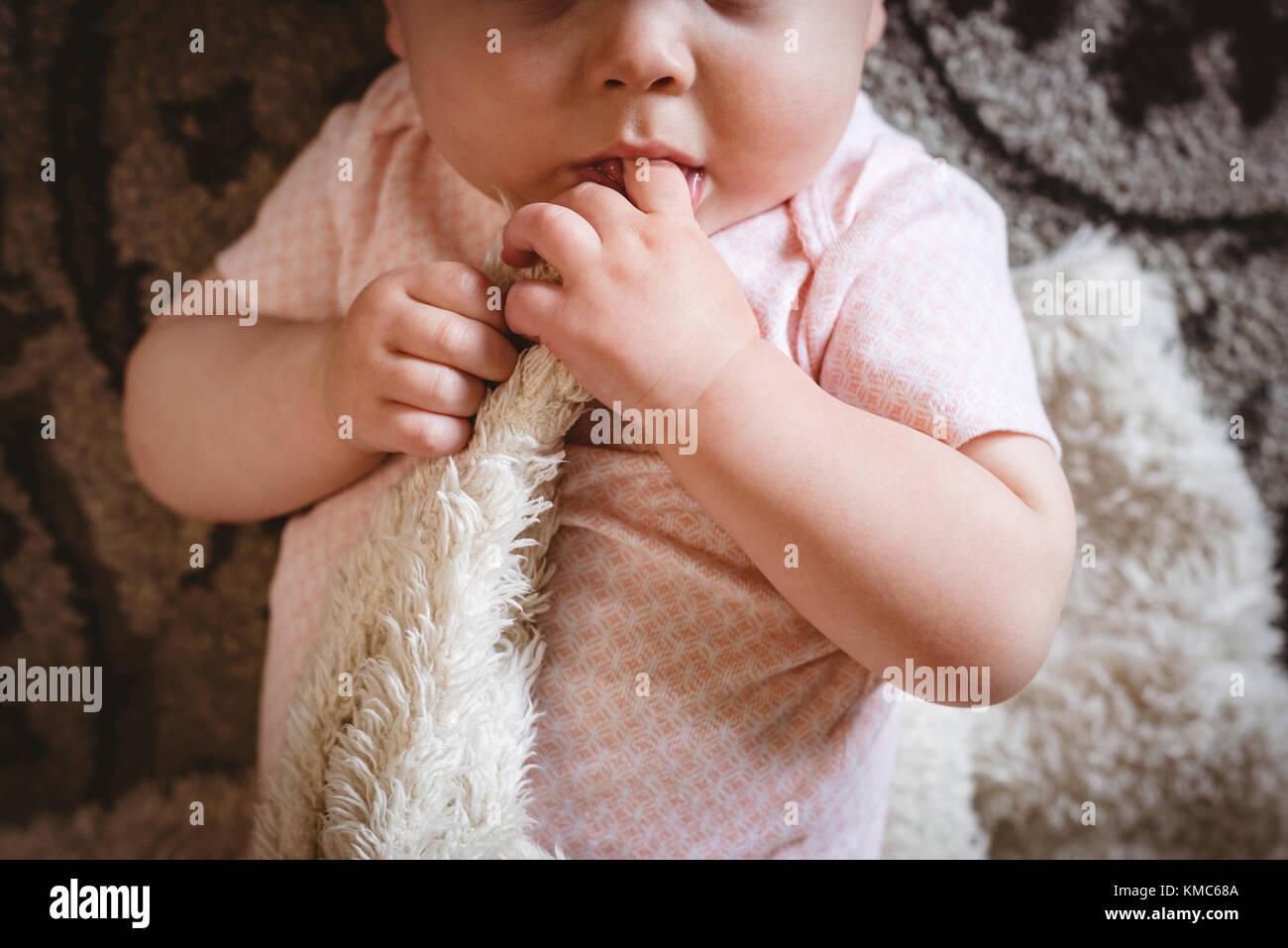 Cute baby lying on blanket - Stock Image