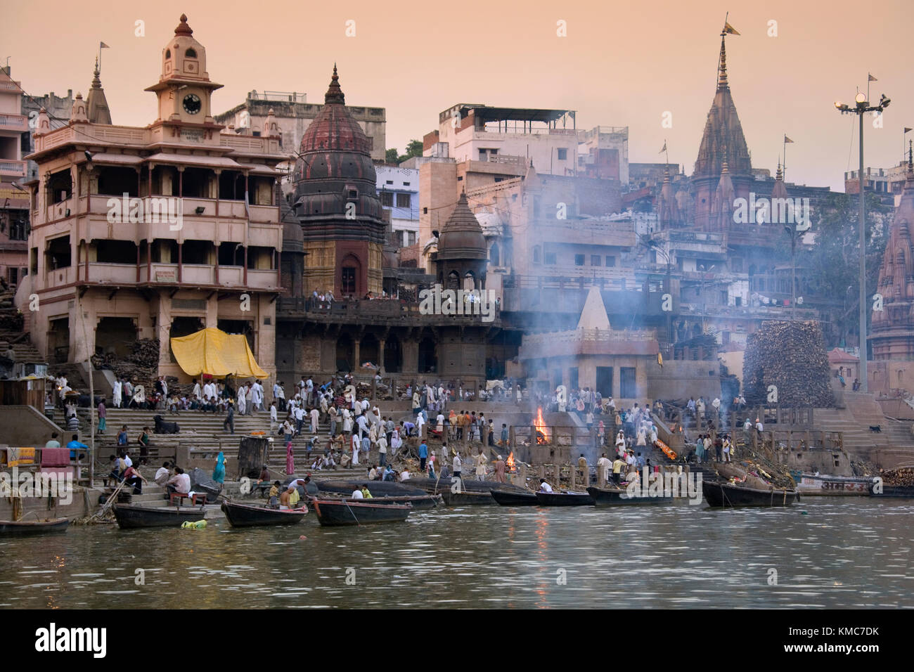 The Hindu Cremation Ghats on the banks of the Holy River Ganges at Varanasi in northern India. - Stock Image