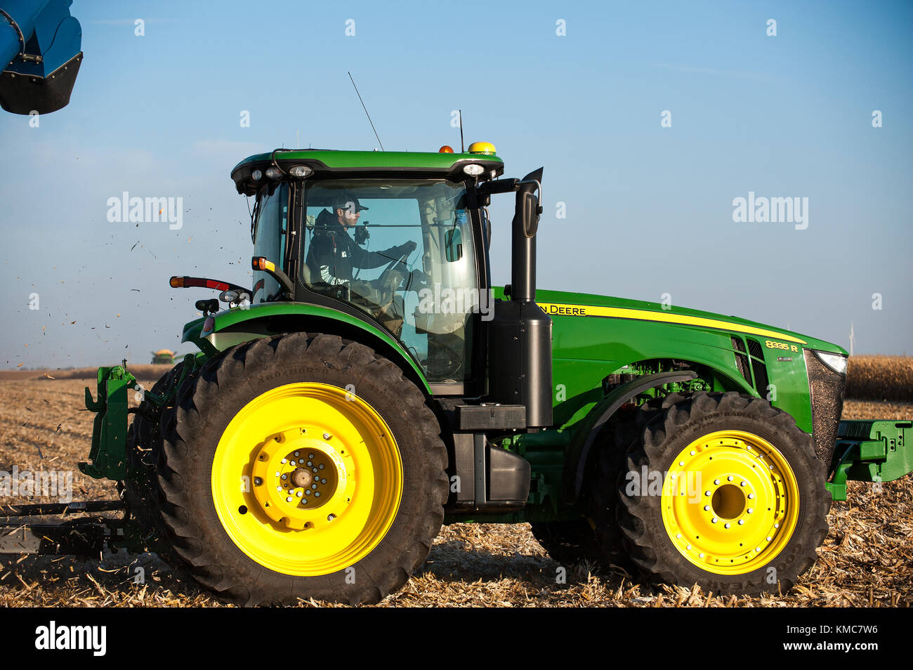 FARMER INSIDE JOHN DEERE TRACTOR CAB Stock Photo: 167456050