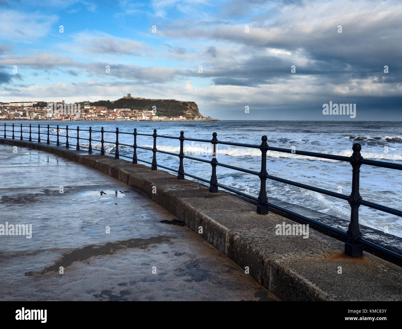 Storm Clearing over Castle Hill viewed across South Bay in Winter at Scarborough North Yorkshire England - Stock Image