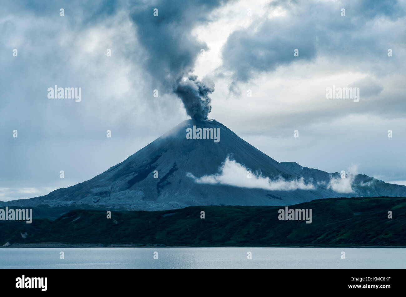 Active volcano throwing ashes on the Russian peninsula of Kamchatka - Stock Image