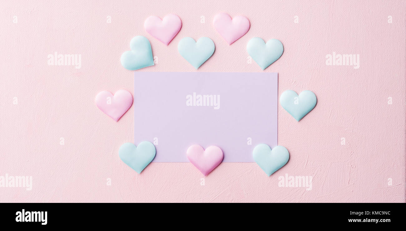 Pastel color card on pink textured background. Baby birthday party ...