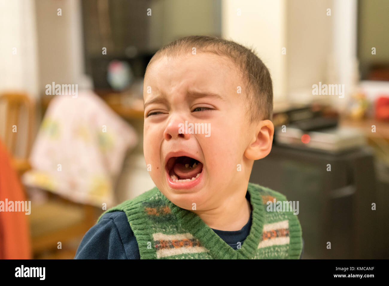 Baby boy loudly cries - Stock Image