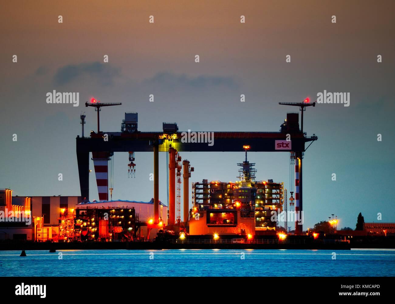 Massive Chantiers de l'Atlantique shipyard construction dry docks. Saint-Nazaire, France. Ocean liner ship building - Stock Image