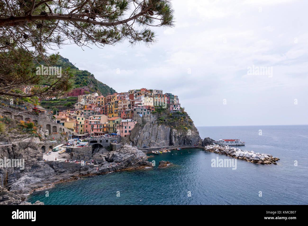 Riomaggiore view along the hiking trail Via dell' Amore (Lovers' lane), Cinque Terre, province of La Spezia, - Stock Image