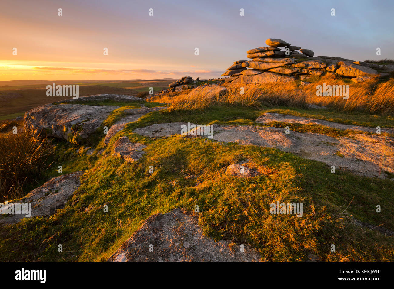 Warm evening light at sundown on the top of Stowes Hill on Bodmin Moor near Minions - Stock Image