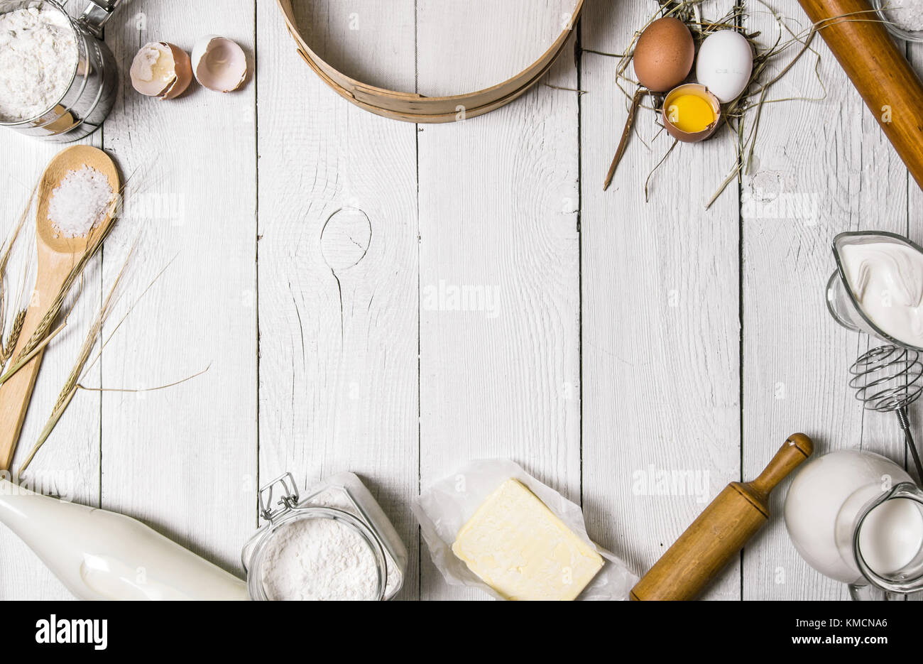 baking background. ingredients for the dough - milk, eggs, flour