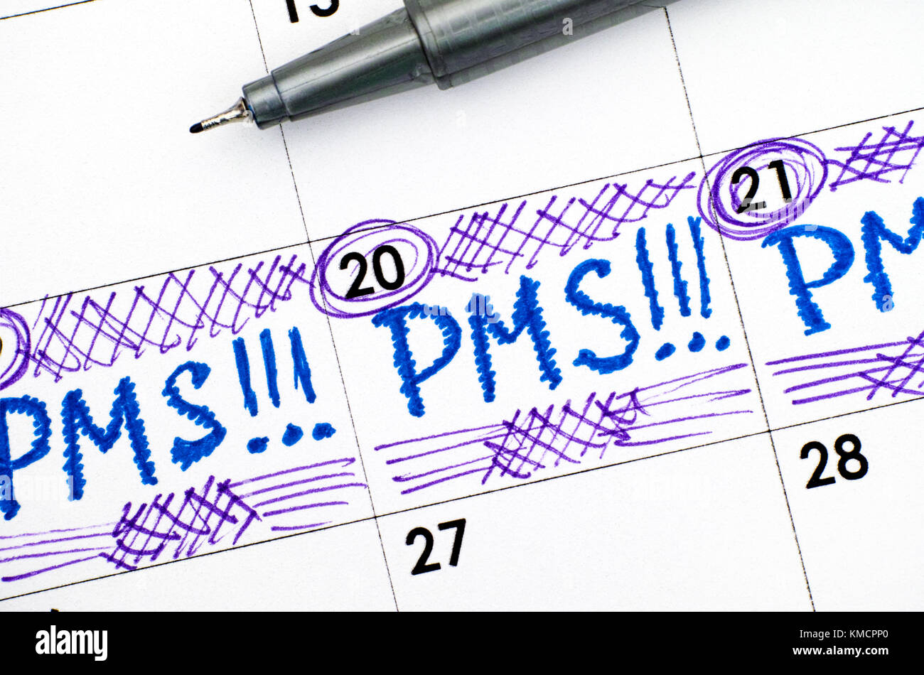 Reminder PMS in calendar with pen. Close-up. Stock Photo
