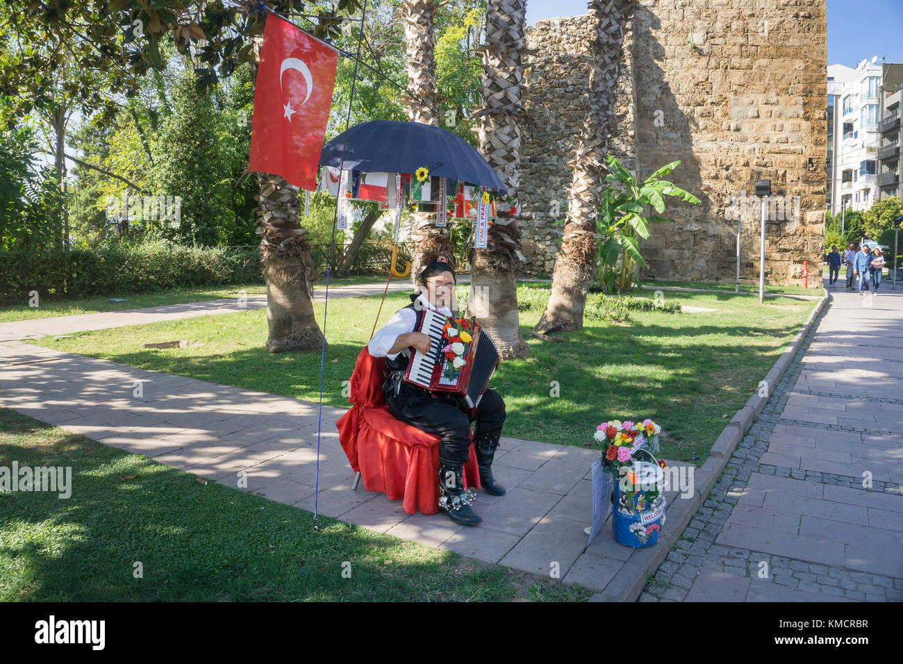 Street musican at Kalekapisi place, upper border to Kaleici, the old town of Antalya, turkish riviera, Turkey - Stock Image