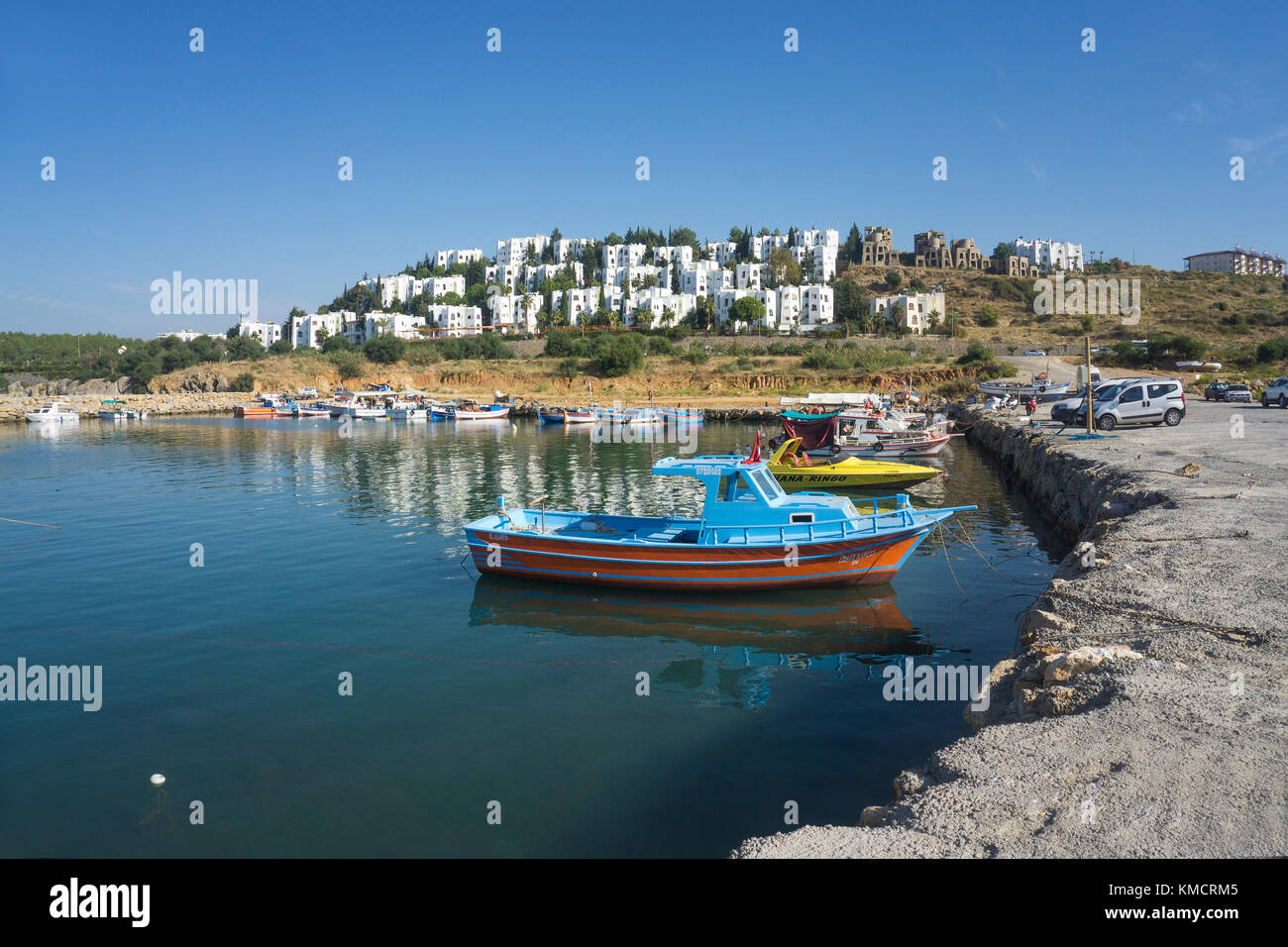 Small harbour with fishing boats at a vacation home village, Avsallar, turkish riviera, Turkey - Stock Image