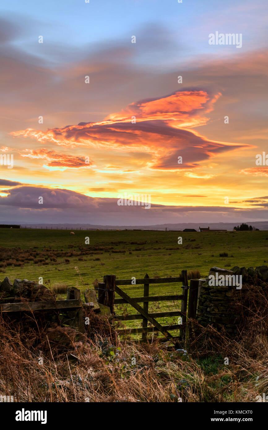 Teesdale, County Durham, UK.  Wednesday 6th December 2017. UK Weather.   Shepherds Warning Sky and gathering storm - Stock Image