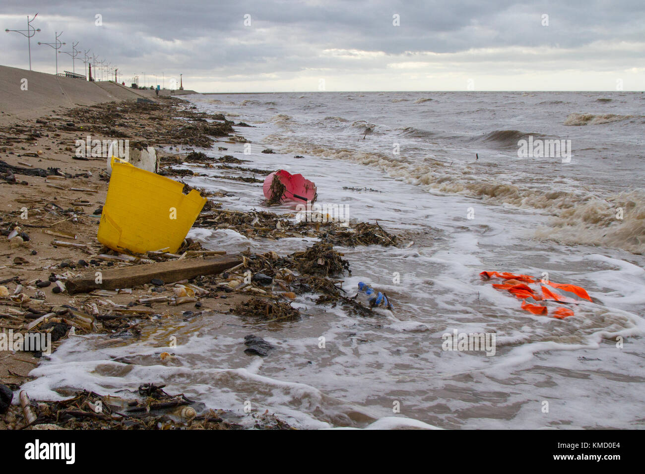 Southport, Merseyside, UK Weather. 6th December, 2017.  High Tide at the resort brings in plastic debris as Storm - Stock Image