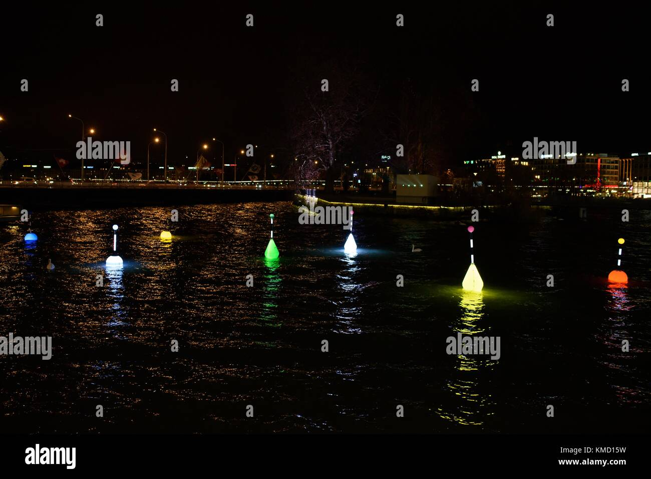 Les Flotteuses for 4th edition Geneva Lux from Stéphane Durand. Colorful floats in the Lake of Geneva. - Stock Image
