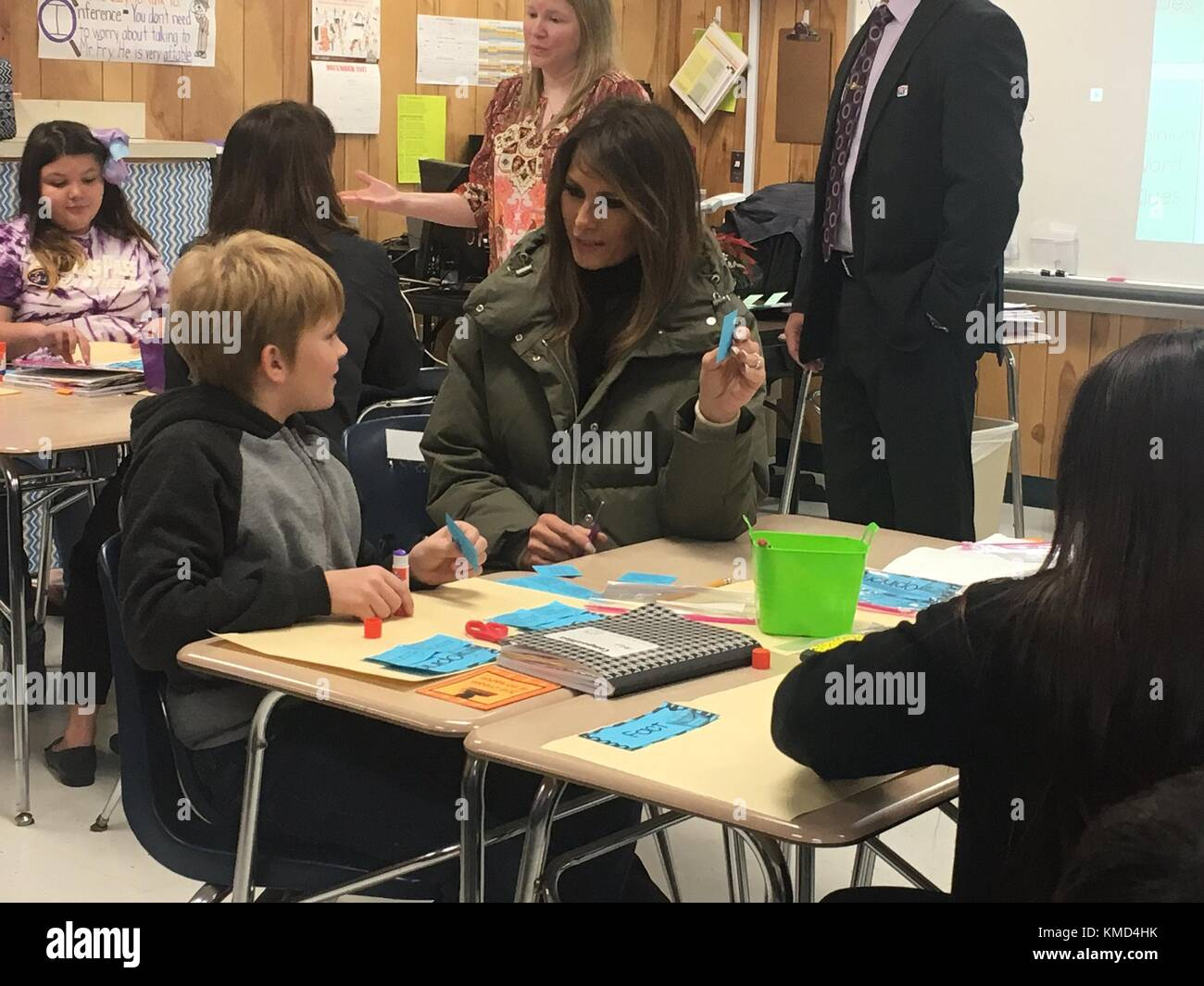 Texas, USA. 06th Dec, 2017. U.S. First Lady Melania Trump works with a young student during a visit to the Charlie - Stock Image