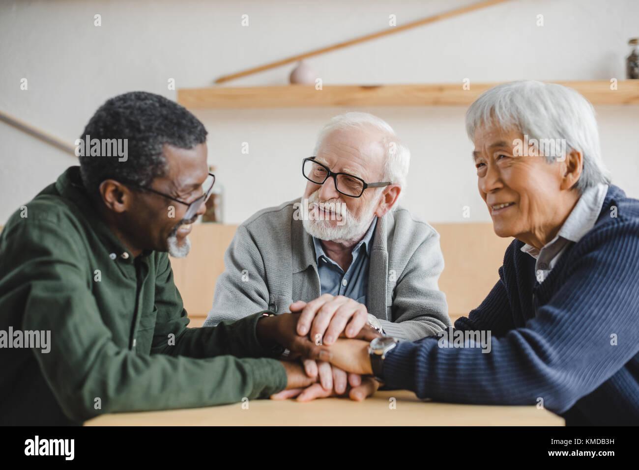 senior friends making team gesture - Stock Image