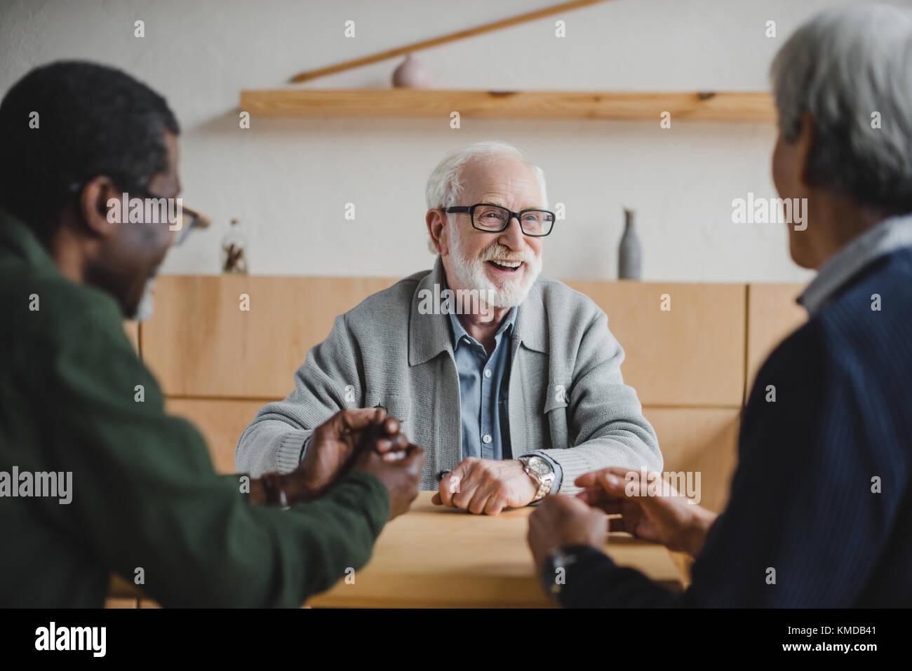 senior friends sharing stories - Stock Image