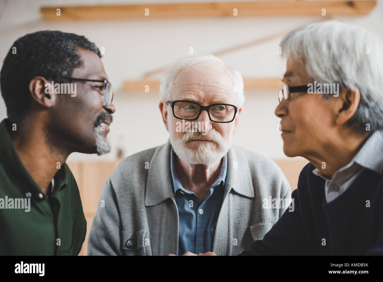 senior friends playing staring contest - Stock Image