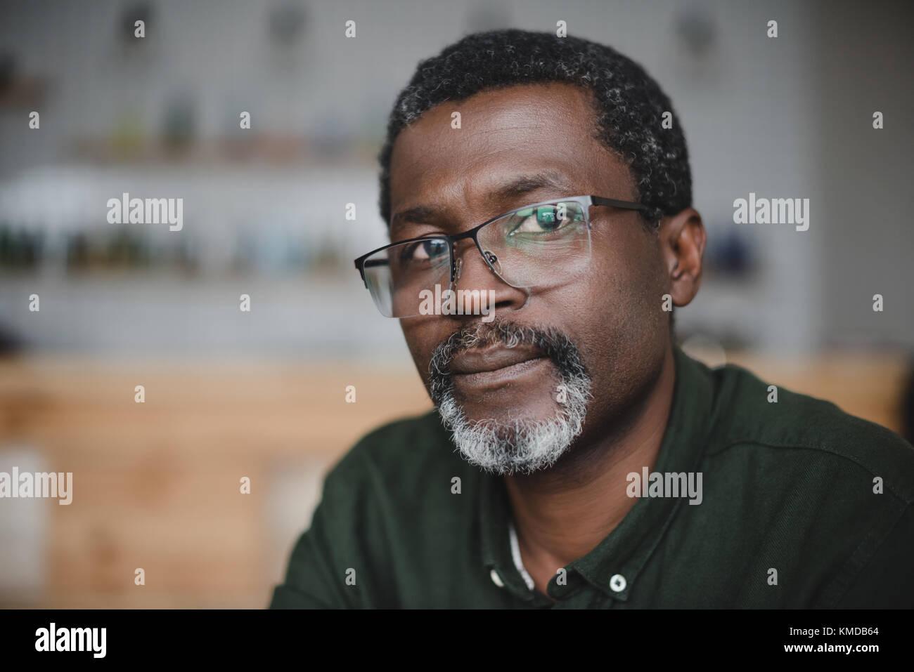 mature african american man in bar Stock Photo