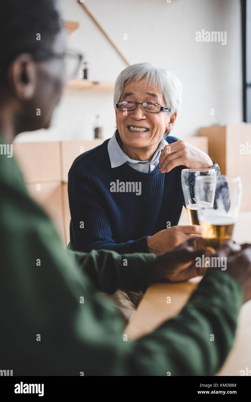senior friends drinking beer - Stock Image
