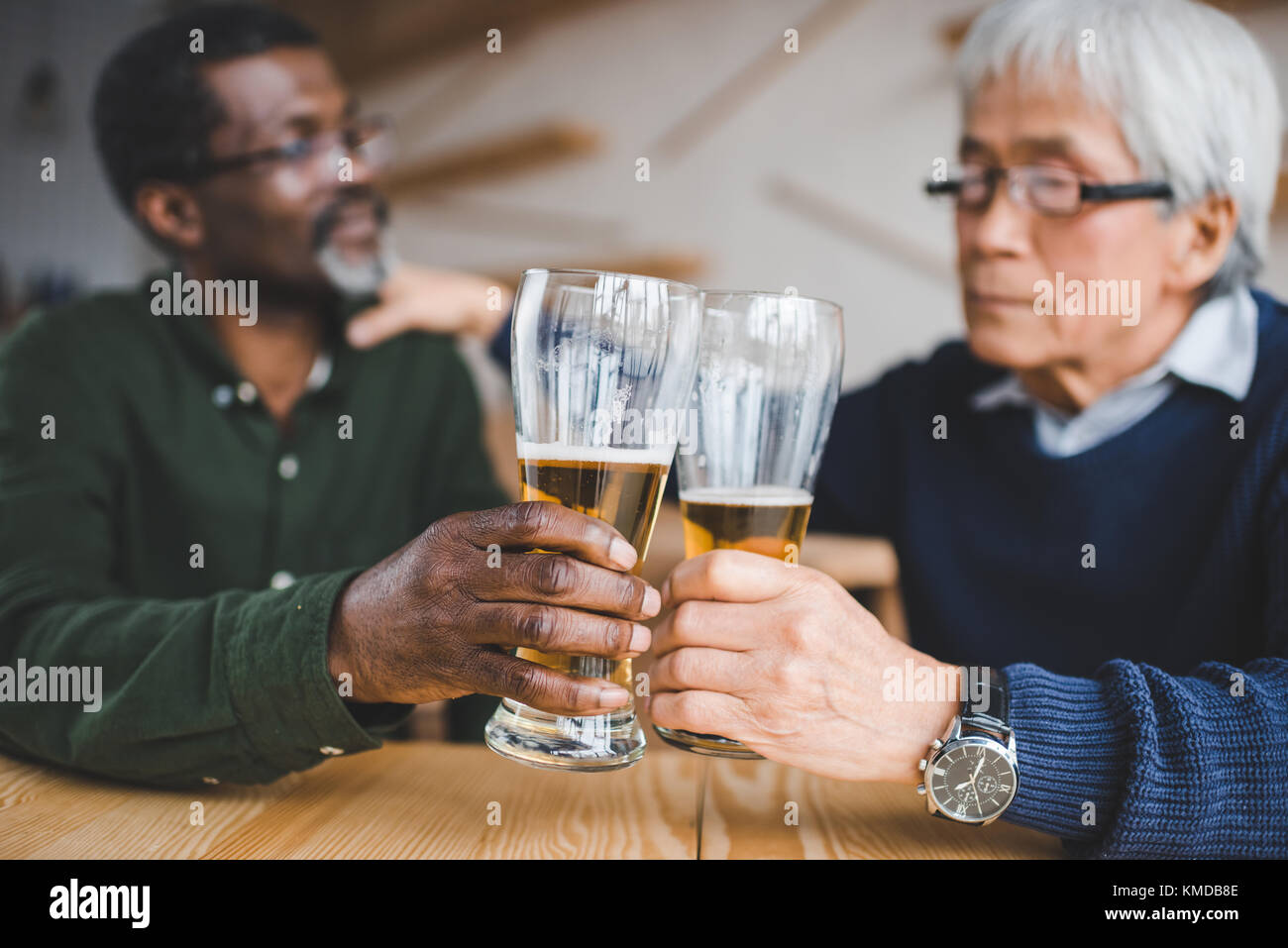 senior friends clinking glasses - Stock Image