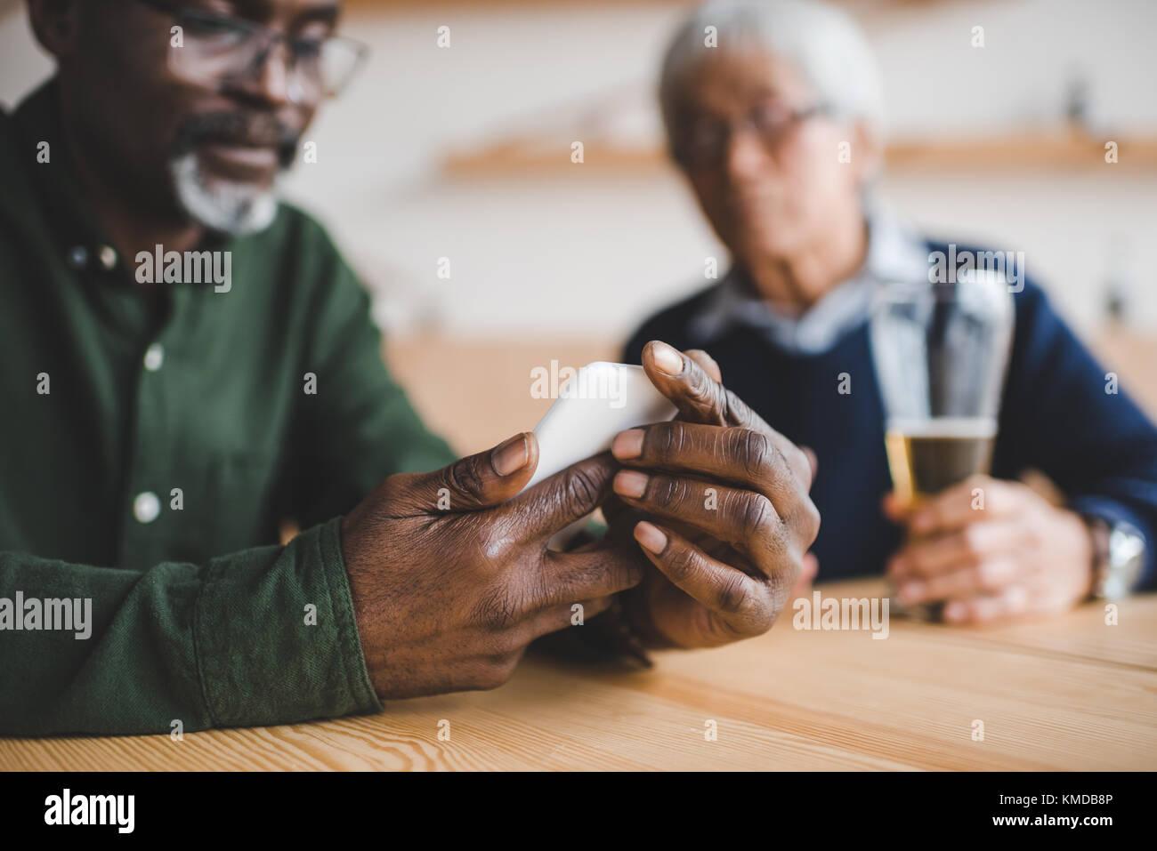 man using smartphone - Stock Image