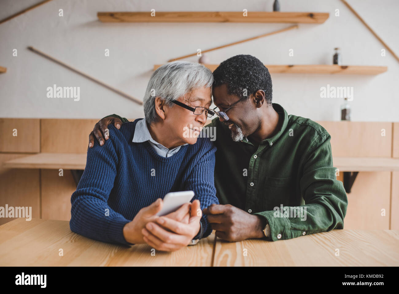 senior men embracing - Stock Image