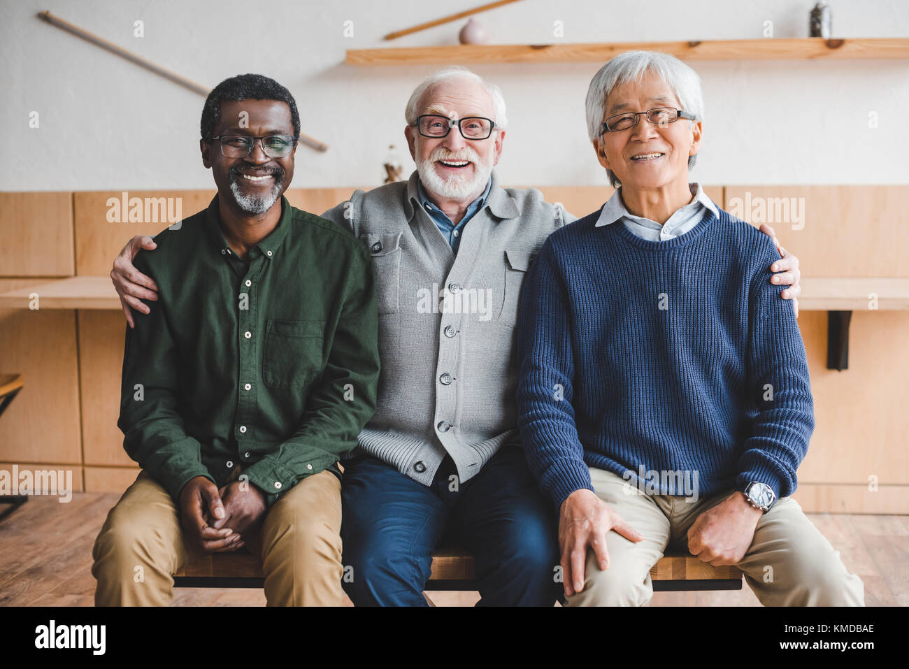 embracing senior friends - Stock Image