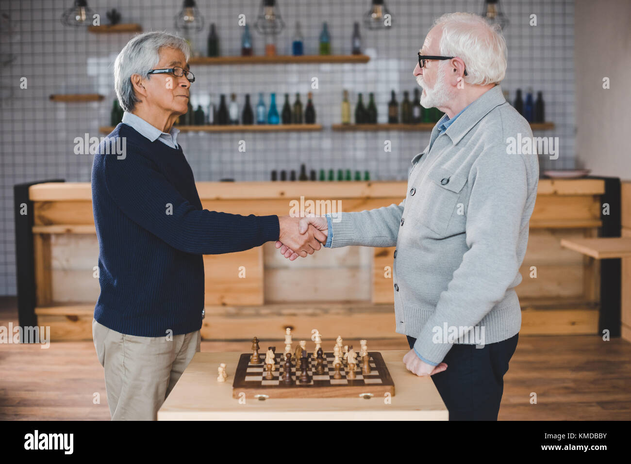 senior men playing chess - Stock Image