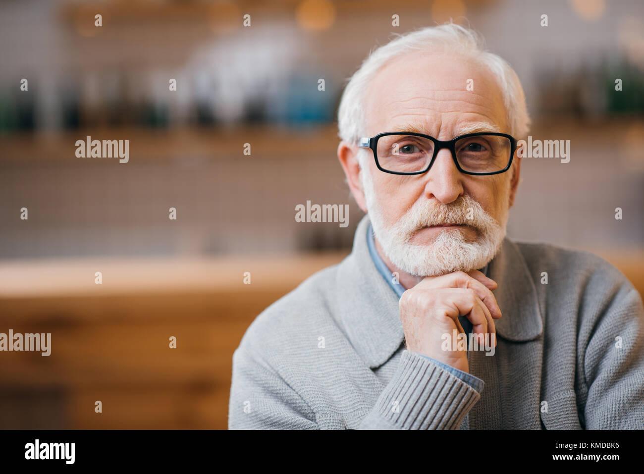thoughtful senior man - Stock Image