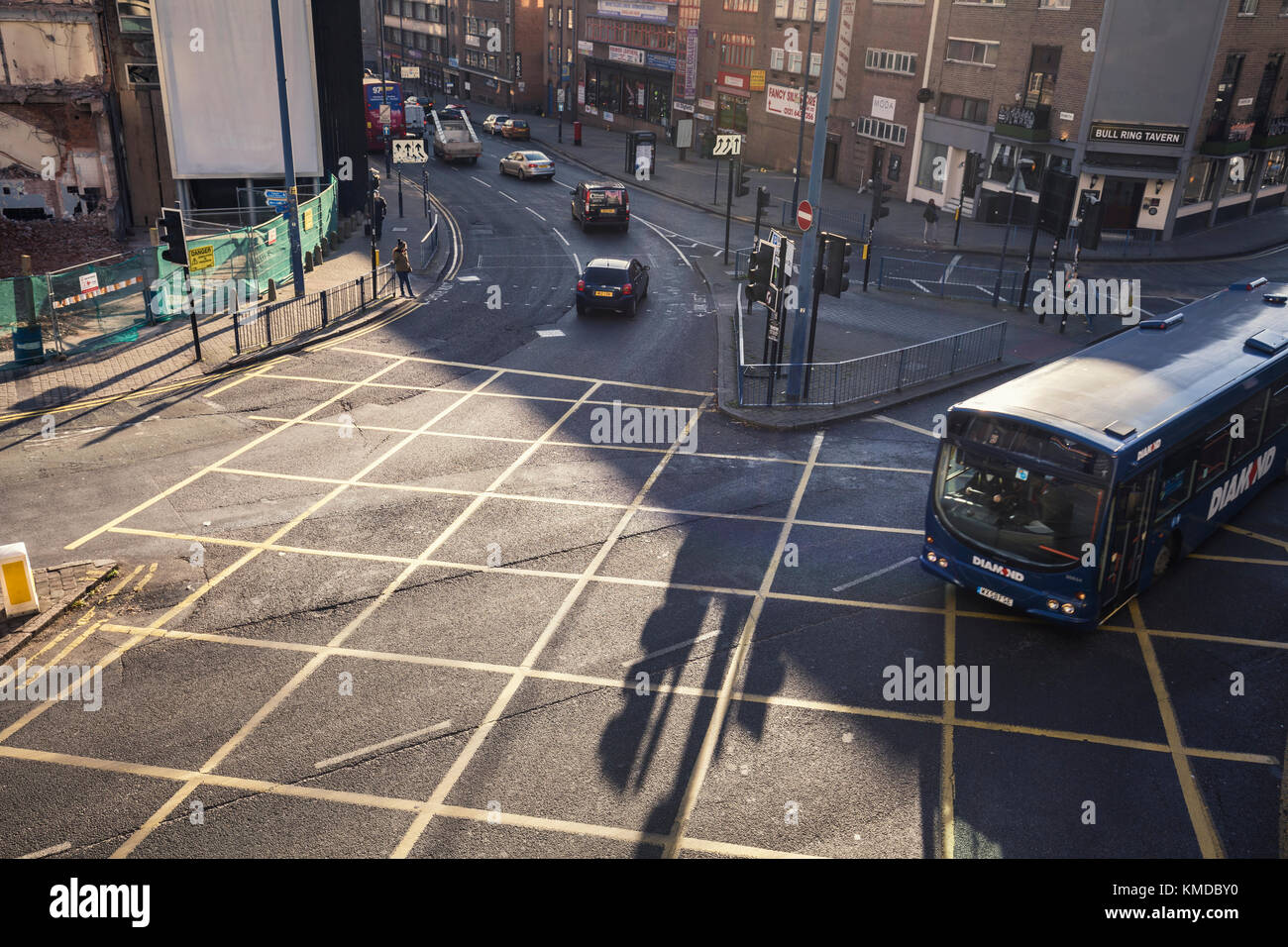 BIRMINGHAM, UK - DECEMBER 01, 2017: Elevated View over Busy Junction with Passing City Bus - Stock Image