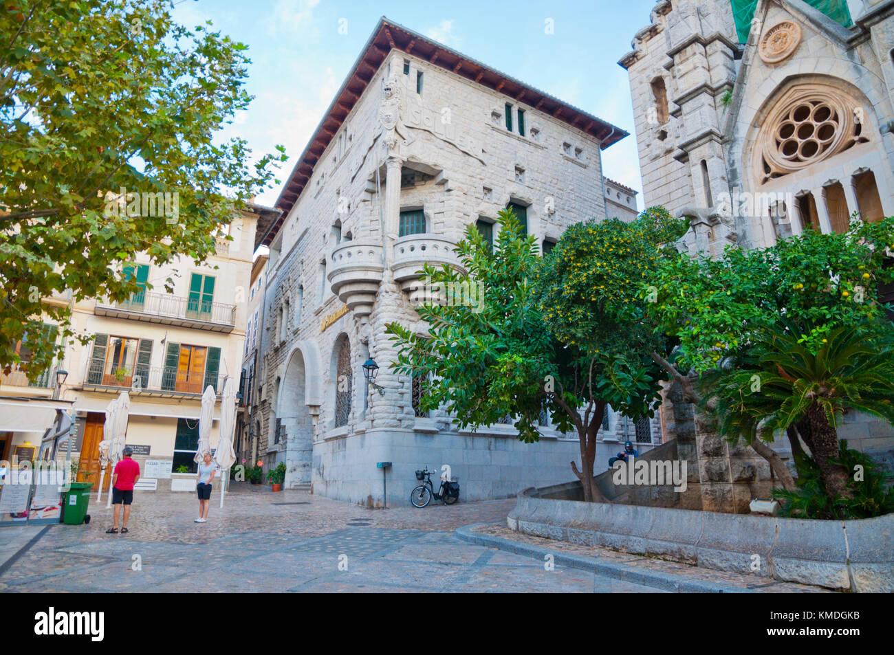 Placa de sa Constitucio, main square, with Banco de Soller building, designed by Joan Rubio i Bellver, Soller, Mallorca, - Stock Image