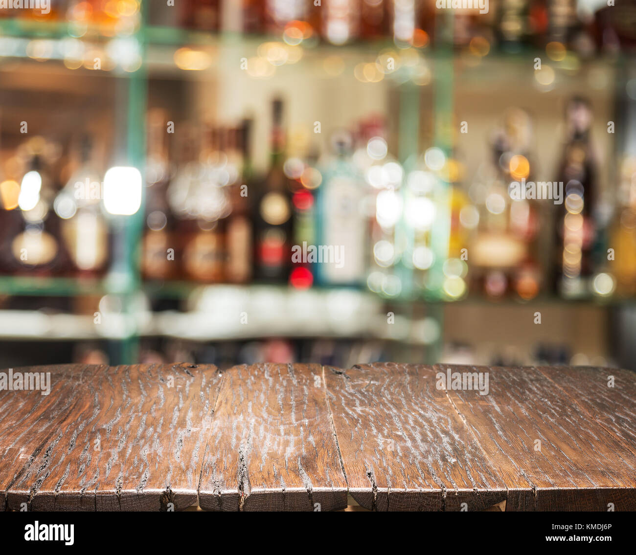 Wooden countertop and blurred bar shelves at the background