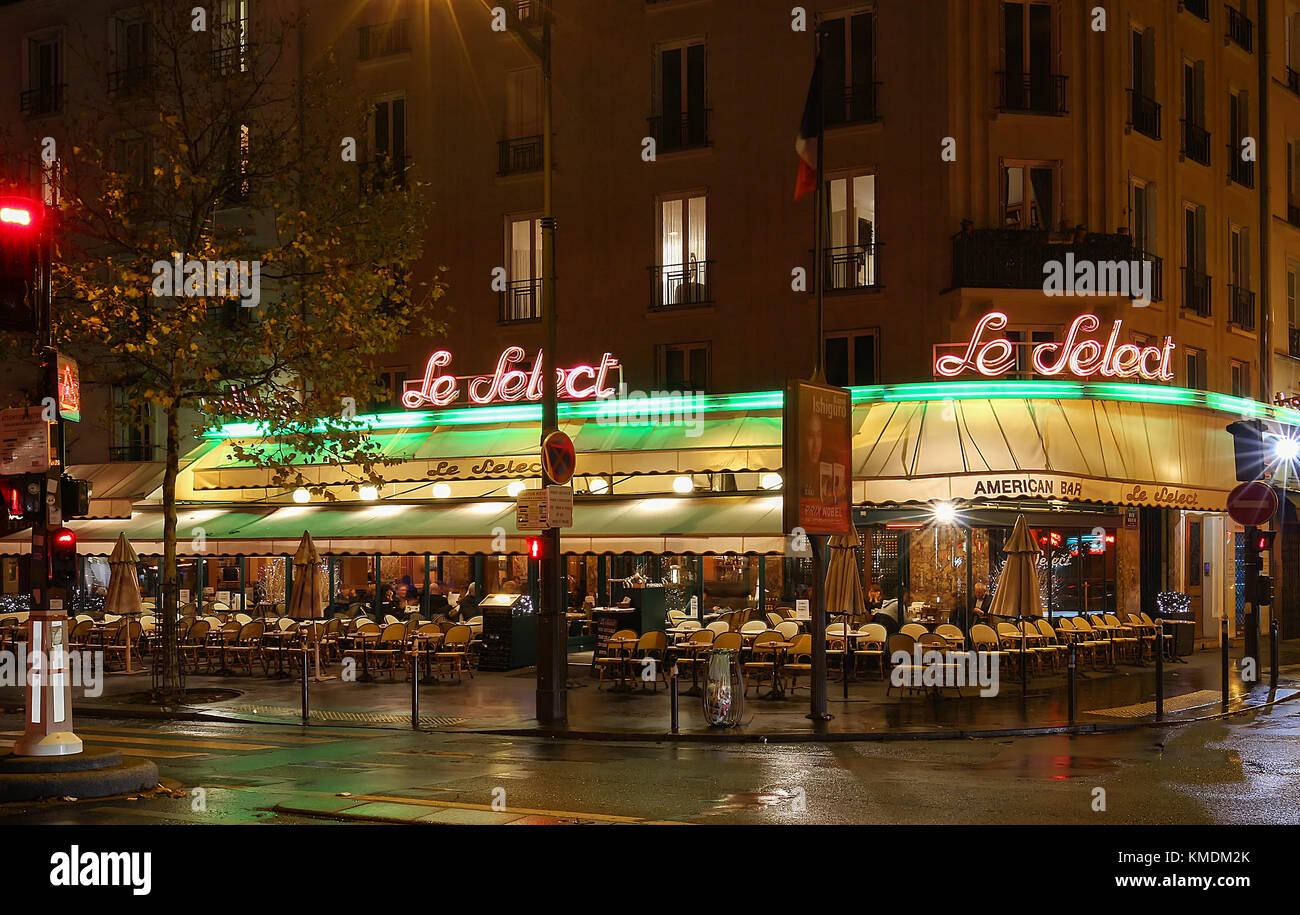 The typical parisian cafe le select decorated for christmas in the