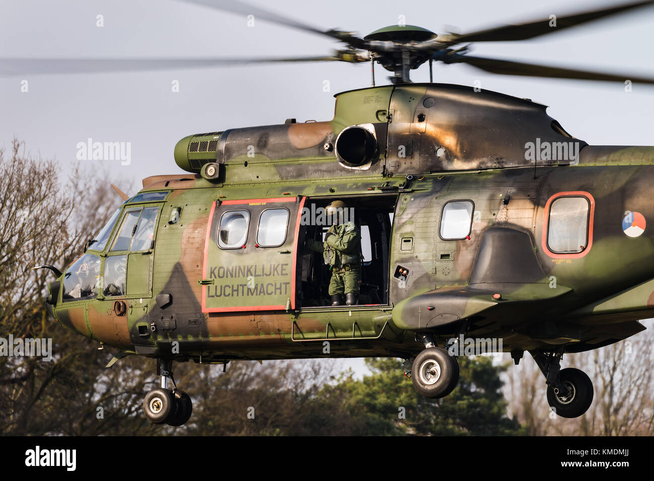 A Eurocopter AS 532 Cougar military transport helicopter of the Royal Netherlands Air Force at the Gilze Rijen Air - Stock Image