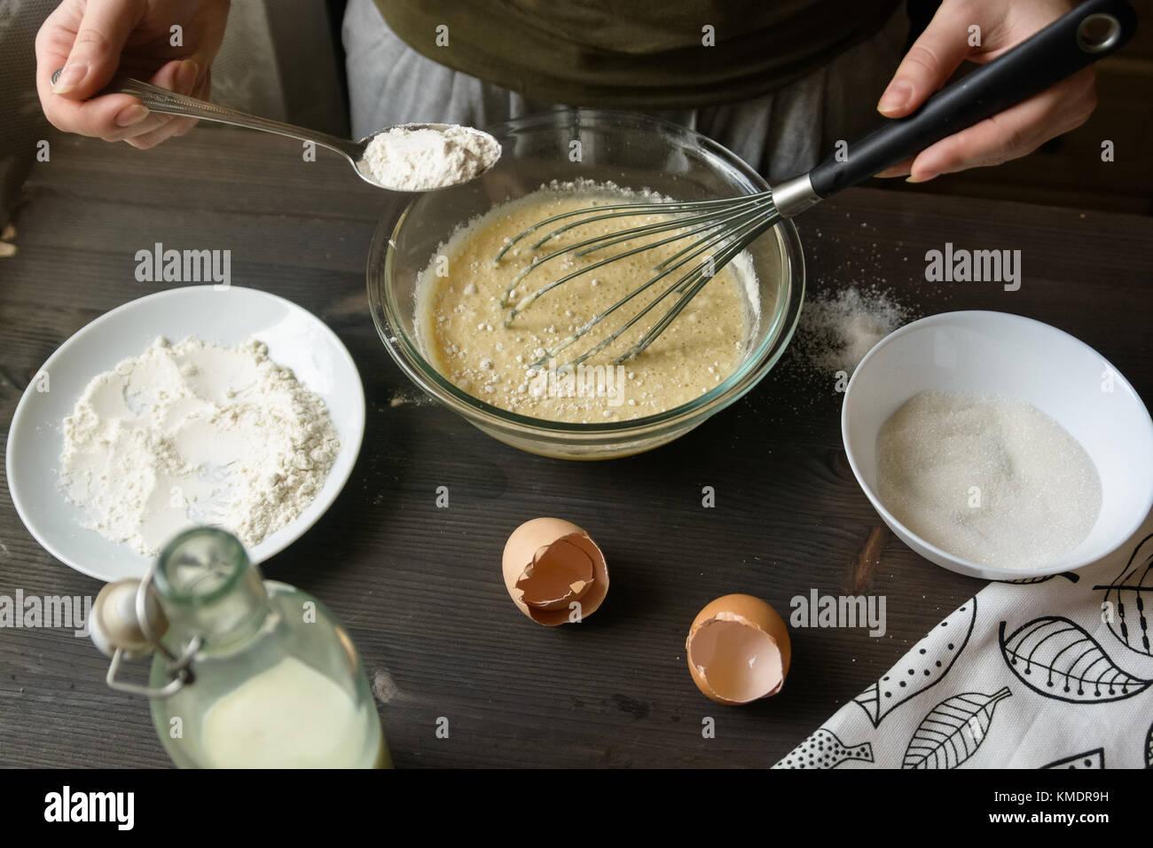 Baking pancakes in rural kitchen - Stock Image