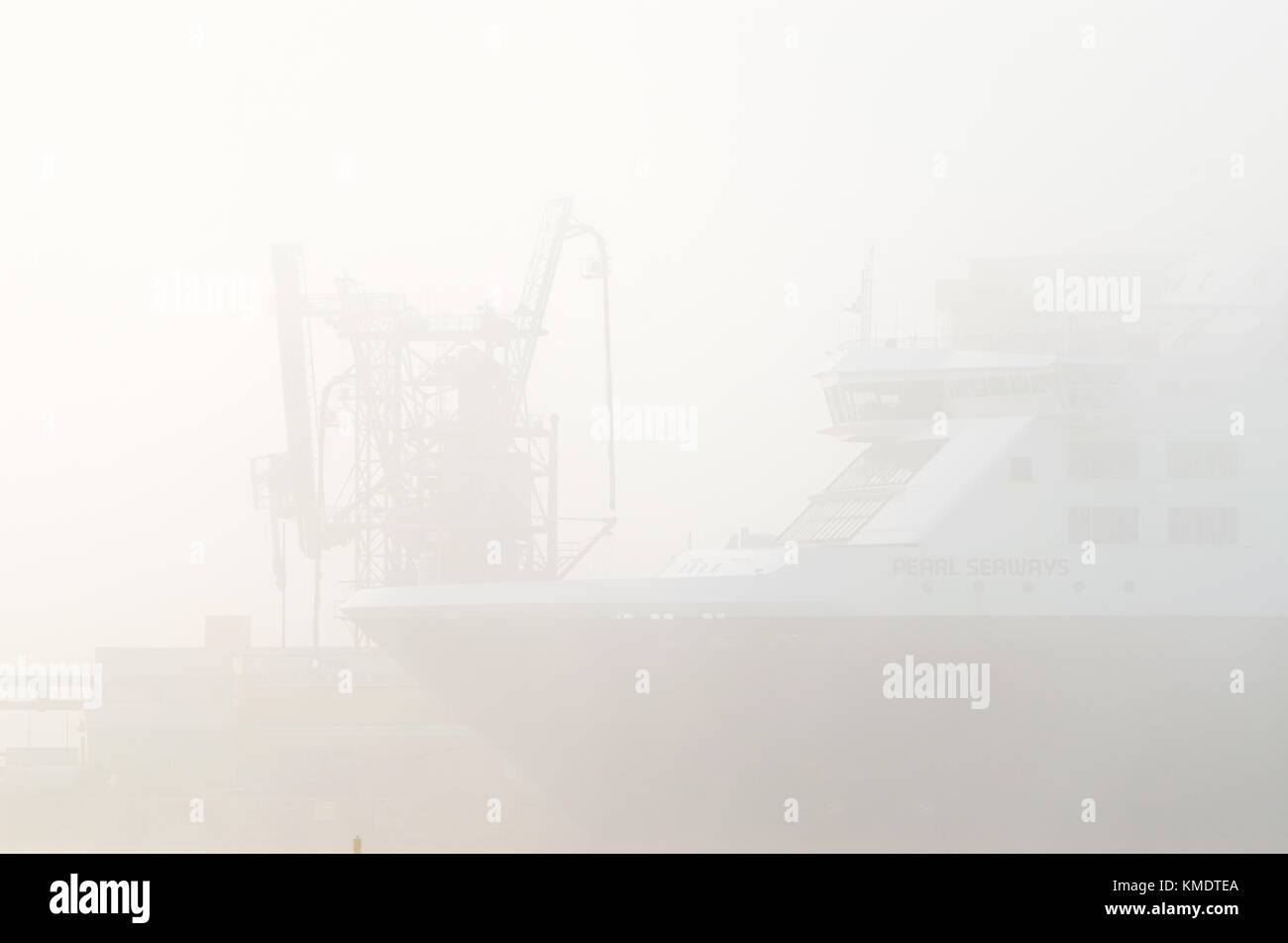 Big Ro-PAX ferry MS Pearl Seaways under heavy fog in Oslo harbour, Oslo, Norway. - Stock Image