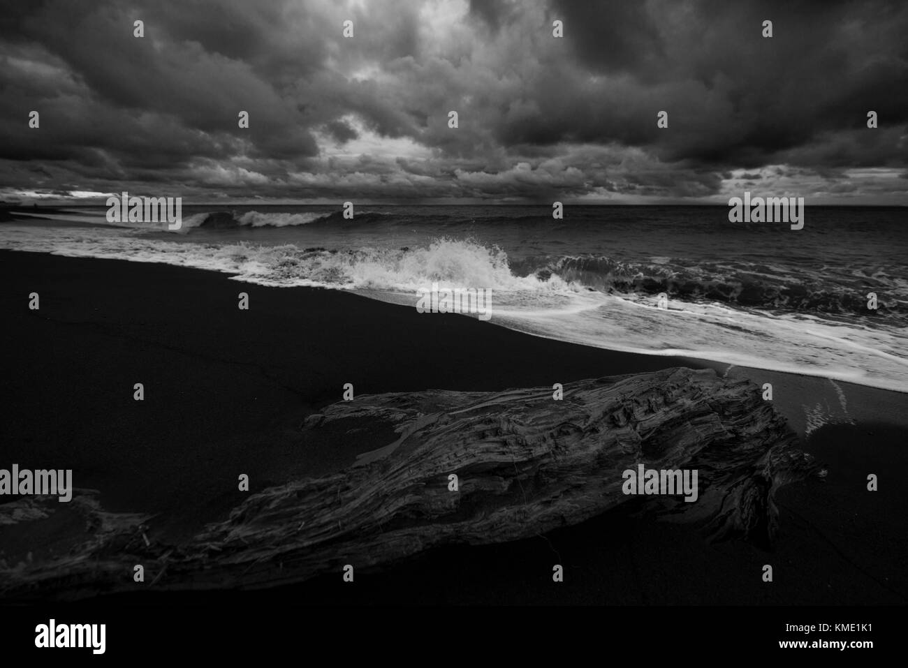Waves rolling onto the beach during a storm - Stock Image
