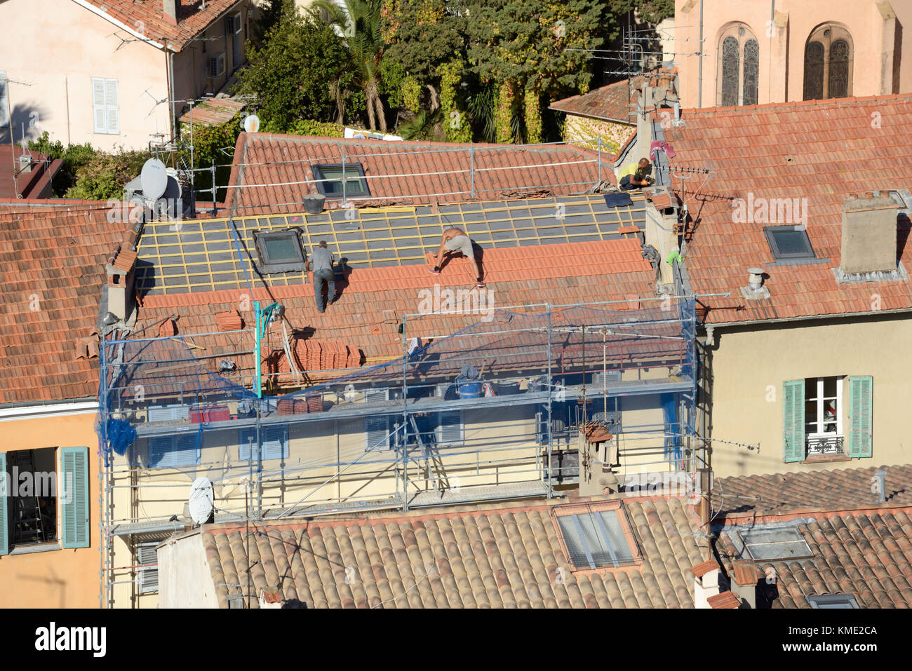 Roofers Retiling Roof or Roof Replacement in Le Suquet Old Town, Cannes, Alpes-Maritimes, France - Stock Image