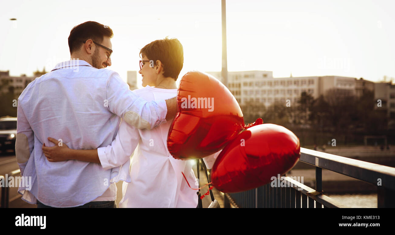 Young couple in love dating and smiling outdoor - Stock Image