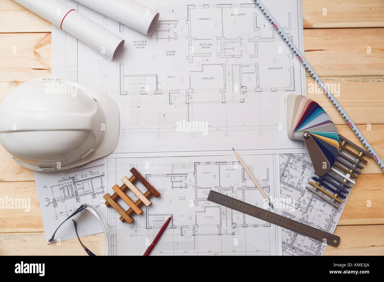 Architecture drawing desk, construction site working with blueprints in the office top view - Stock Image