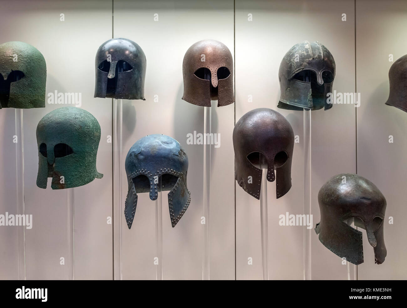 Display of bronze Corinthian style helmets dating from around the 6th to 8th century BC, Archaeological Museum of - Stock Image