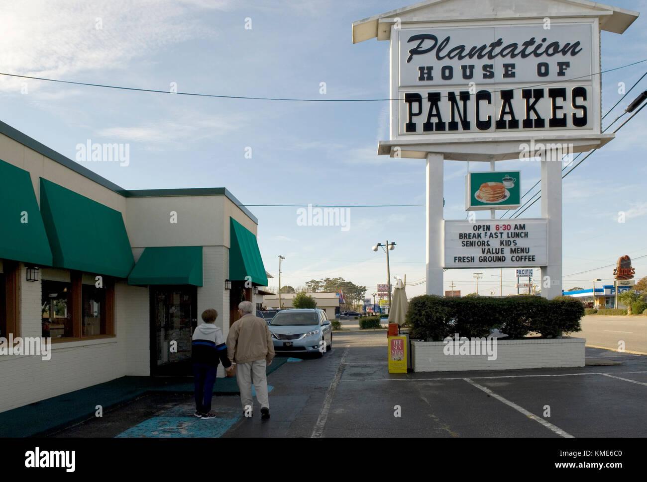 Senior couple walking into breakfast restaurant at Myrtle Beach South Carolina, USA. - Stock Image