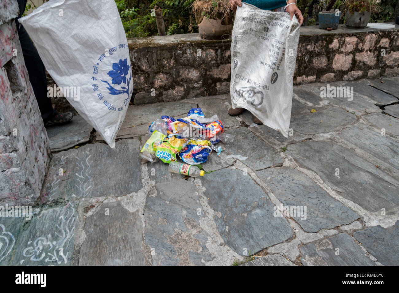 People managing plastic waste to prevent the ill effects of it. - Stock Image