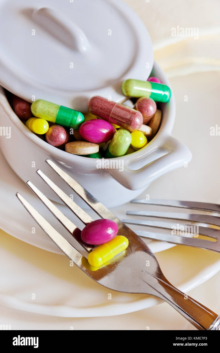 healthcare and wellness - diet and detox, diet pills and tablets, measuring tape Stock Photo