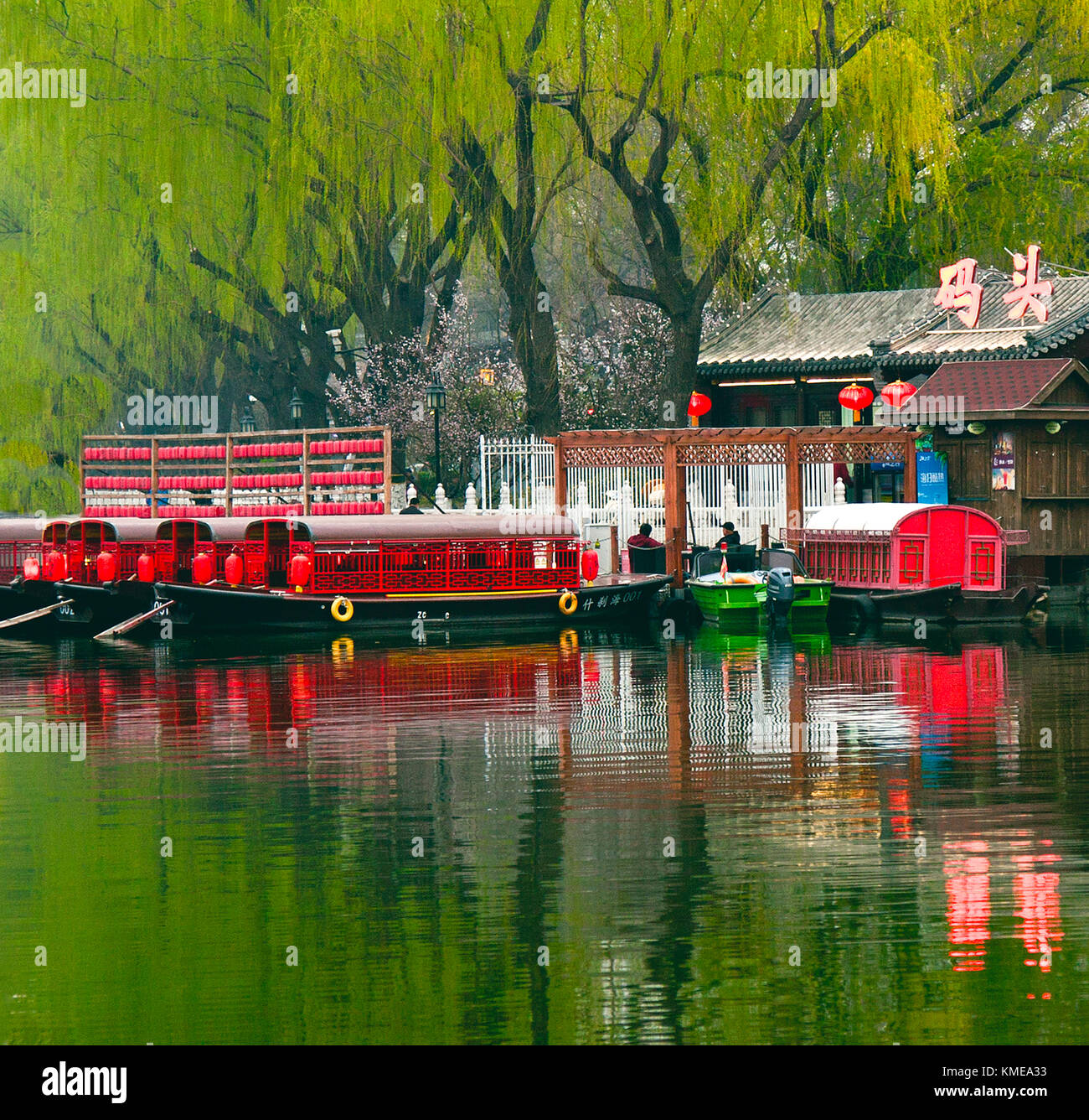 Dinner boats await customers at early twilight,Shichahai (Houhai) District at Twilight,Beijing,China. - Stock Image