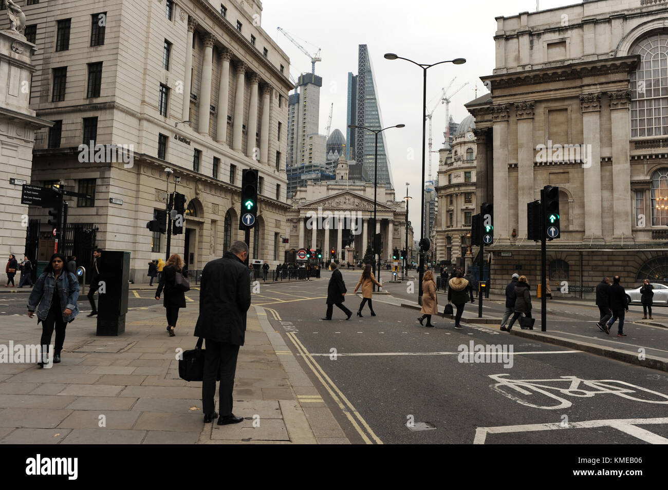 City workers cross the road on Queen Victoria Street in London, England Stock Photo