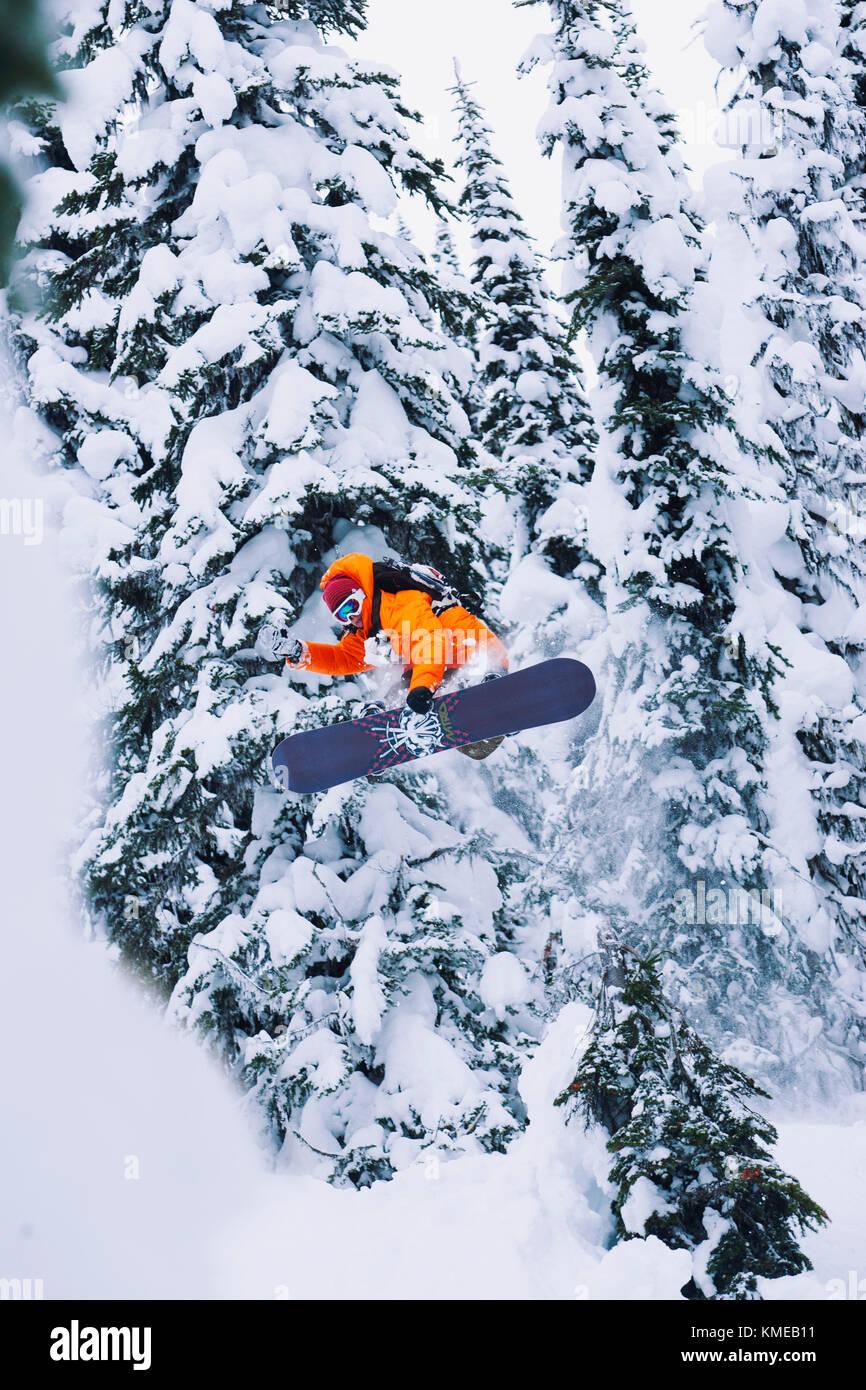 Austin Granger snowbaording at Mica Creek Heli,Mica Creek,BC,Canada - Stock Image